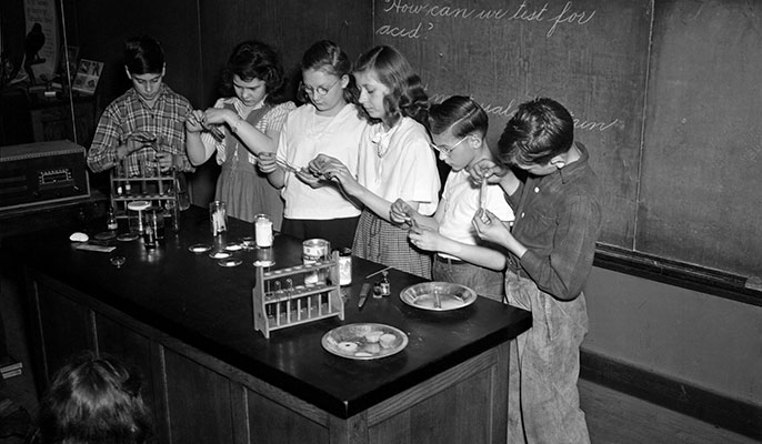 Old photo of students in a science class