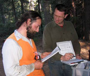 Andrew Larson, '03, '09, and Jim Lutz, '05, '08, review data from the Yosemite Forest Dynamics Plot