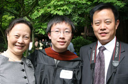 Ziyu Ma, �10, with proud family at commencement.