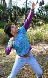 Nalini Nadkarni shoots a line into a tall tree.