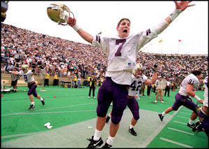 Husky Damon Huard celebrates UW win over California, 1993