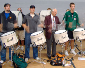 Bert Pound rocks out with HMB Drumline members.