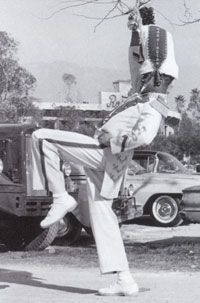 Drum major Bob Flennaugh practices in front of the Rose Bowl.