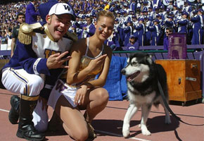 Drum Major Tyler Leitch and Feature Twirler Catherine Watters with Husky mascot Dubs.