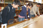 Students examine the scroll
