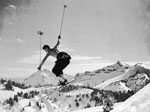 Skier making a cornice jump near Edith Creek, southeast slope of Mount Rainier, date unknown. Photo by Dwight Watson