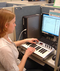 Senior Michelle McKenzie demonstrates the music composition software.