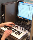 Workstation with MIDI keyboard and music composition software