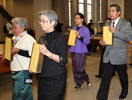 Thai delegates present the 40-volumne canon to the UW Libraries