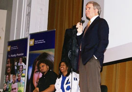 Amosa, left,  Brown and  UW President Mark Emmert