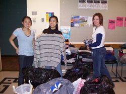 Sandy, Alisa & Ruby surrounded by donations