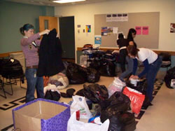 OSSW students sort through 50 bags of clothing