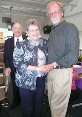 Ruth Huber with Roger Roffman, her former professor; in back husband Don looks on.