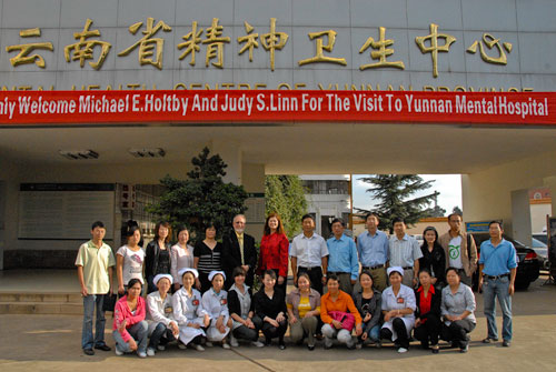 Michael Holtby and his wife, Judy, with doctors and nurses at the Yunnan Department of Mental Health