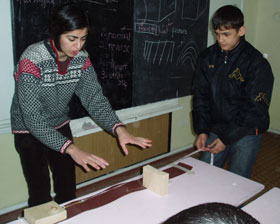 Mohadjer works hands-on with students