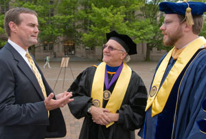 From left: Malcolm Cleary, Dean Emeritus Michael Eisenberg, and Associate Dean Matthew Saxton