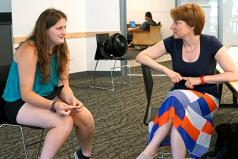 A student discusses interview strategies with an employer.