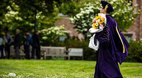 A PhD graduate walks to their ceremony.