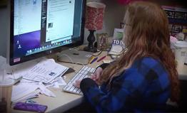 A graduate student uses the computer.