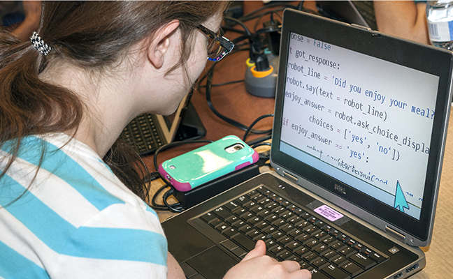 A student with low vision works on a computing project