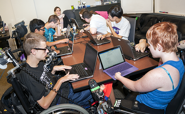 A diverse group of students working on individual computing projects