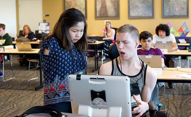 Two students with disabilities work together on the computer.
