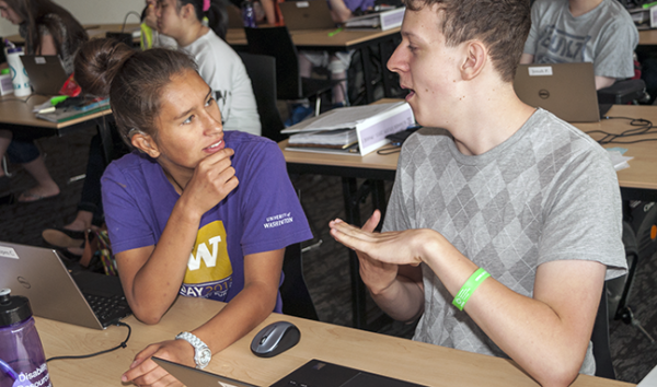 Two students who have hearing impairments discuss a computing project