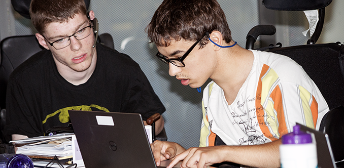 Two students working on a computing project