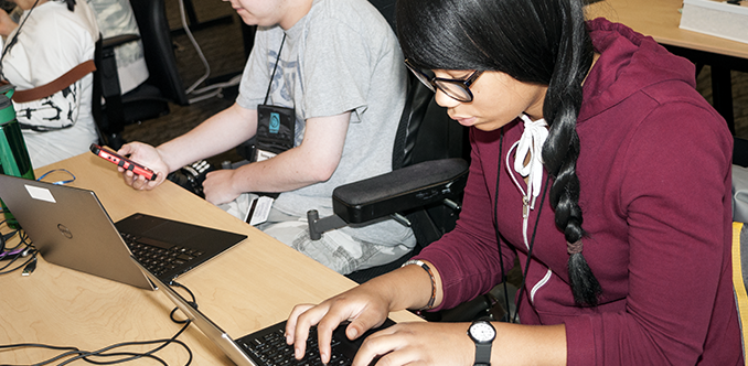 Two students working in a computer lab