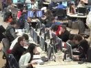 Still image from video: Students working in a large open computer lab