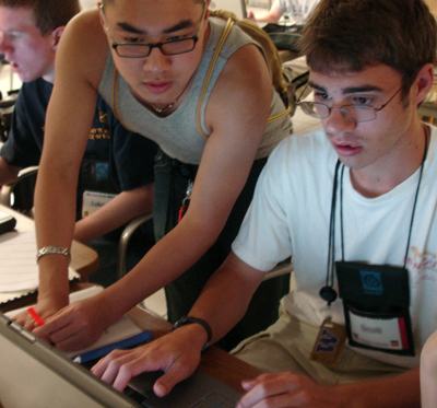A peer helping a student on the computer