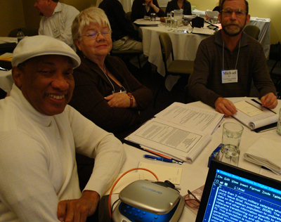 Three CBI participants sit around a table