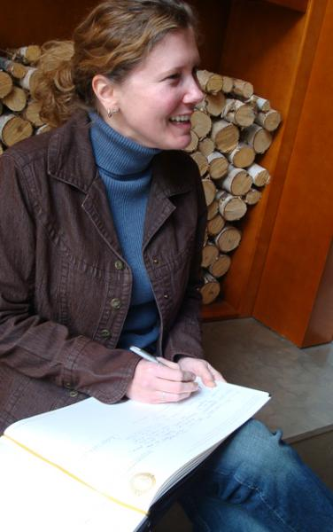 A woman takes notes