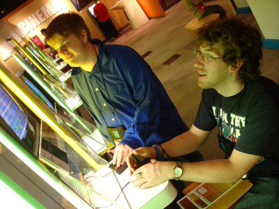 Two students interacting with a computer