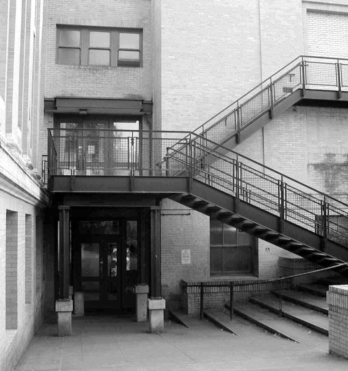 Entrance #5 to ground floor at rear of building