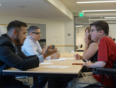 A DO-IT Scholar gets interviewed by a faculty mentor during a mock interview prep session.