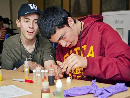 Image of two students working together during a science lab.