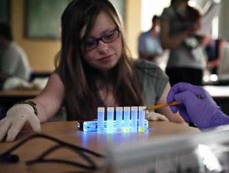 Image of a student conducting a science experiment.