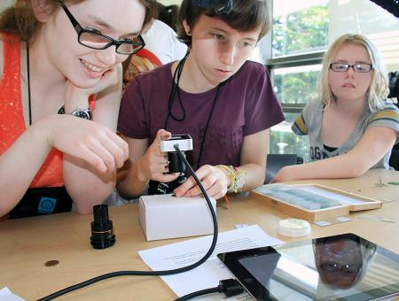 Image of students using science equipment during EXO labs.