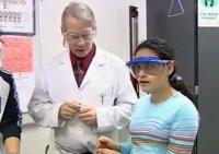 still image from video Equal Access Sensory showing students performing an experiment with an instructor