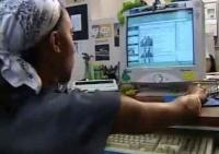still image from video Learning and Earn Tips showing DO-IT Scholar using assistive technology at computer