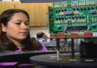still image from STEM showing student in an electronics lab