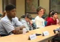 still image from video Self Exam showing DO-IT Scholars watching a presentation