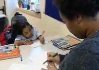 still image from video Taking Charge 3 showing DO-IT Scholar Jessie working with a mentor