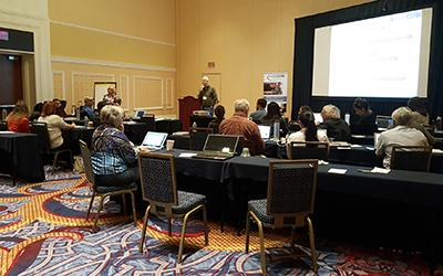 Attendees actively listen to a presentation.
