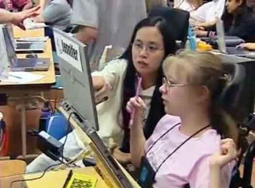 still image from video Equal Access Universal Design in Instruction showing two female DO-IT Scholars using assistive technology at a laptop computer