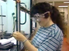 still image from video College YCDI showing DO-IT Scholar performing a science experiment