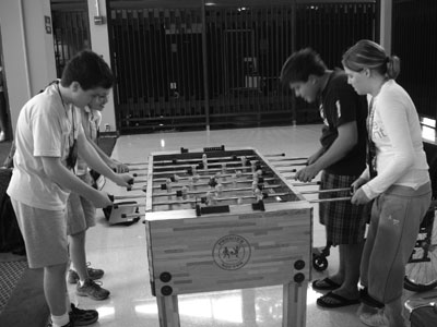Picture of Scholars playing foosball.