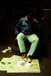 Picture of Dan Locke painting with his feet