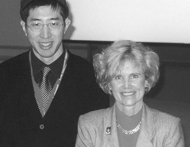 Picture of director Sheryl Burgstahler  and interpreter Mamoru Iwabuch